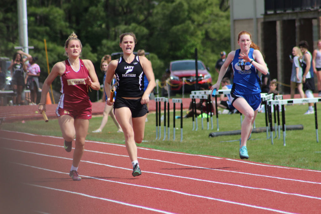 Senior Jenson Williams gives everything she has in the anchor leg of her relay team going on to earn the first place ribbon, points for the varsity girls team, and eventually a first place finish for the Panthers varsity girls.
