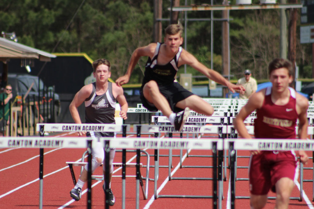 Senior Andrew Galloway clears the hurdles in the 110 meter race.